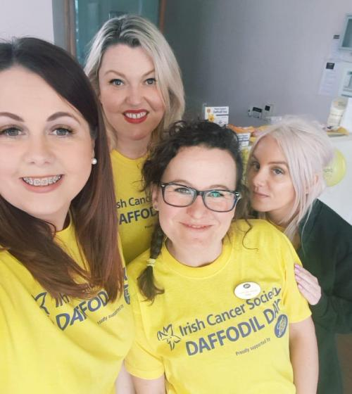 Employees at a Daffodil Day coffee morning
