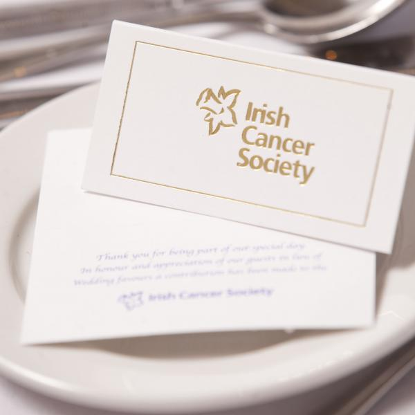 Irish Cancer society wedding cards laid our on a table