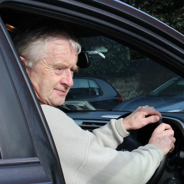Volunteer driver in his car