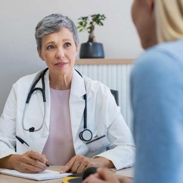 Doctor talking to a female patient