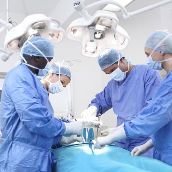 Doctors and nurses in surgery