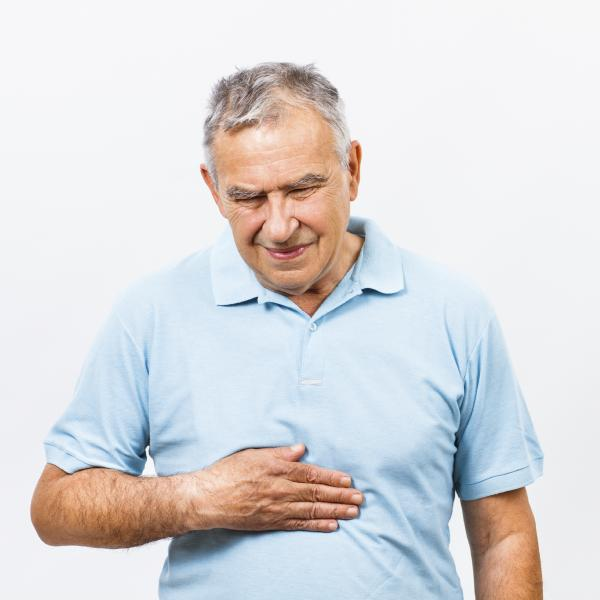 Older man touching his stomach