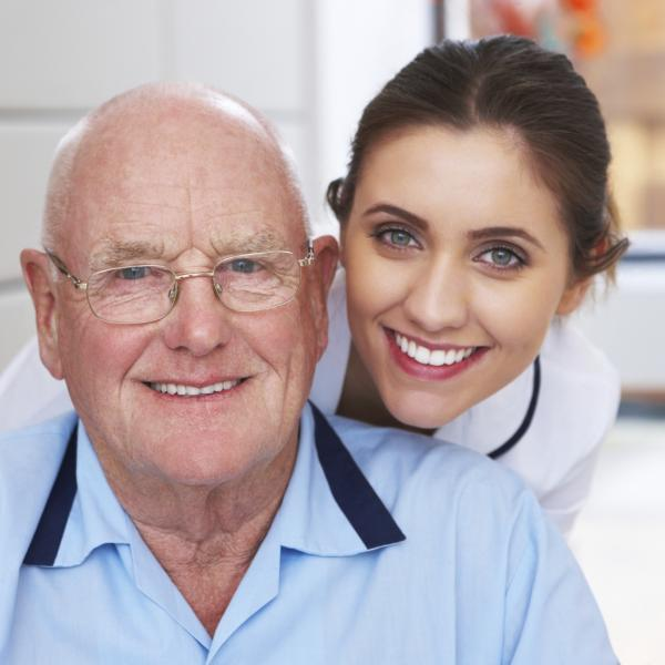 Older man with young female doctor