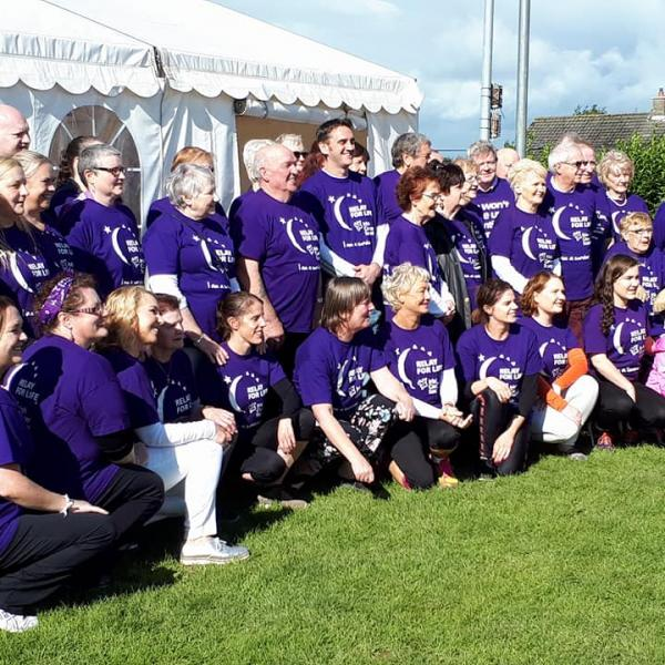 Cancer survivors in purple t-shirts at Relay For Life Offaly