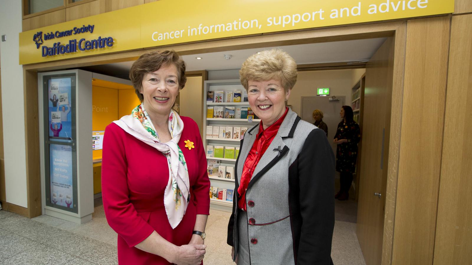 Cancer nurse and volunteer in front of a Daffodil Centre