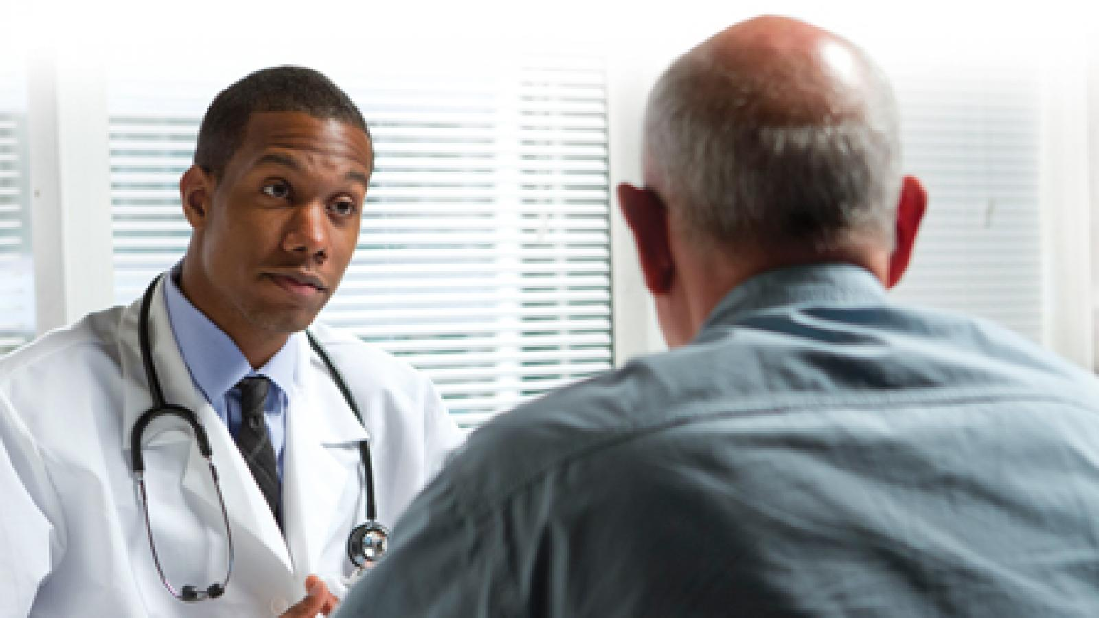 Doctor talking to a male patient