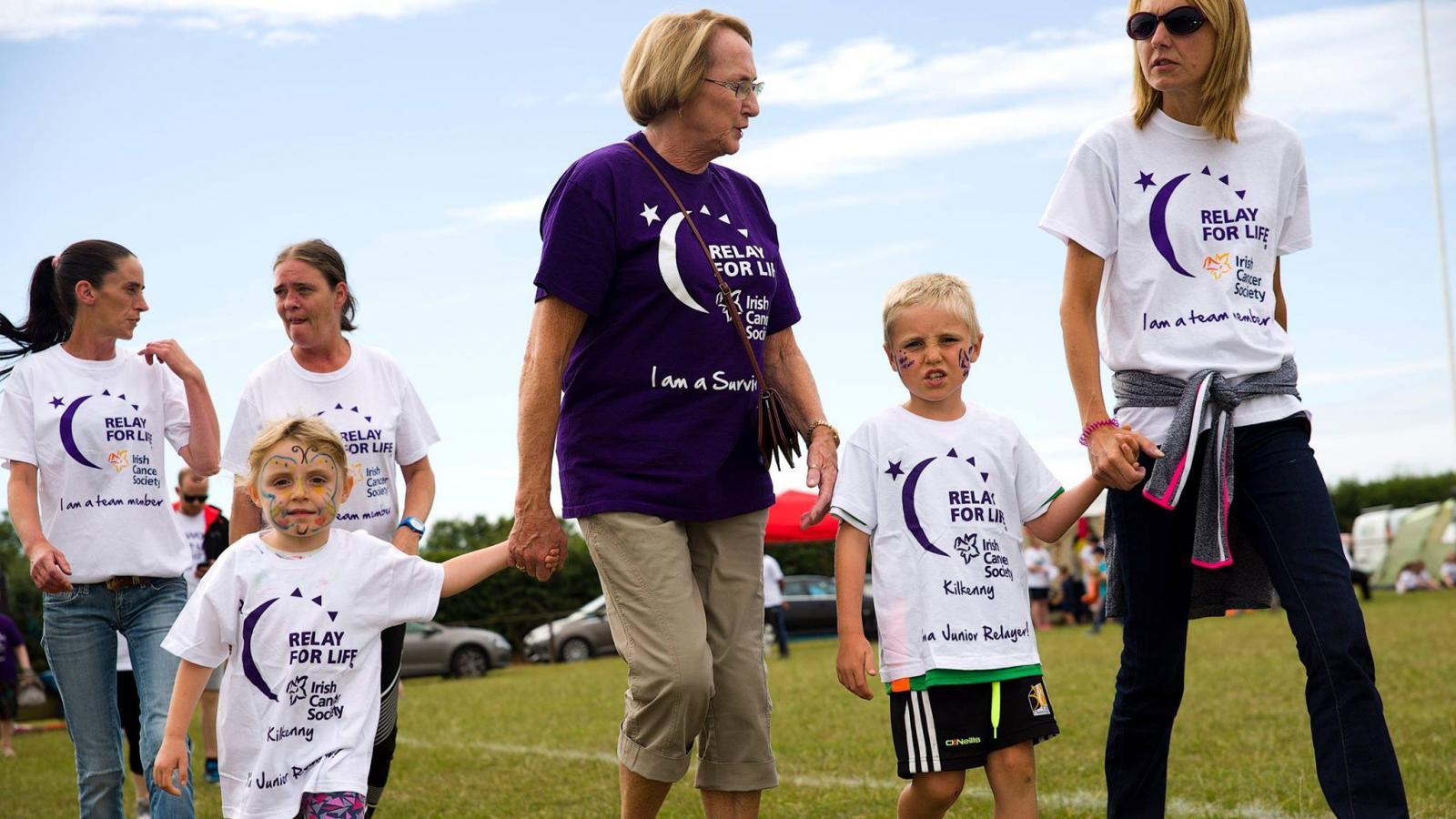 Grandparents walking with children at Relay For Life Kilkenny