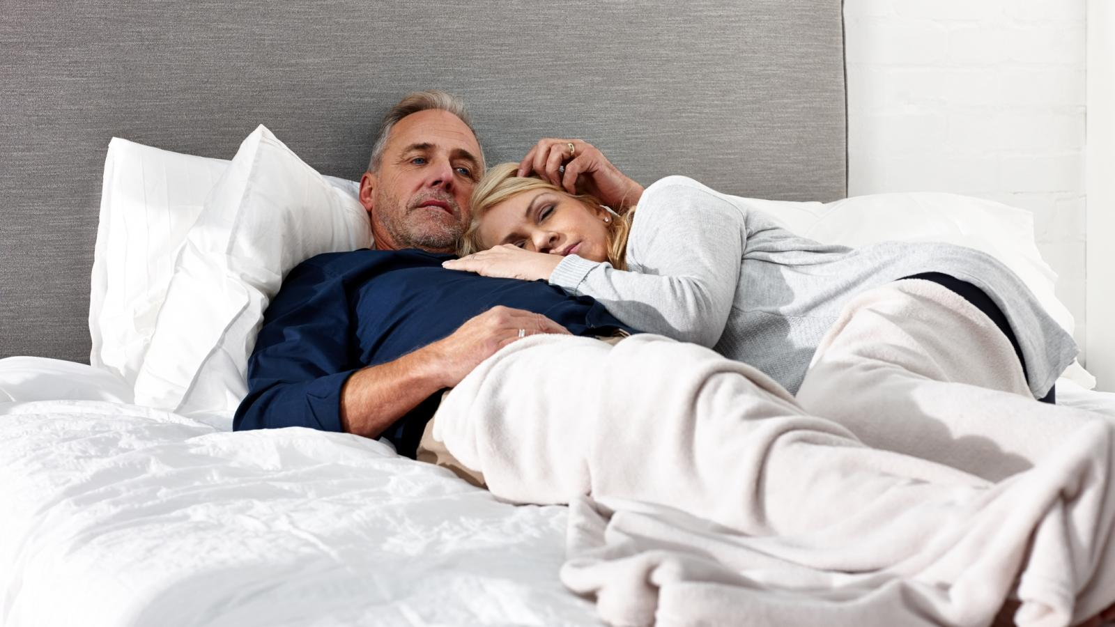 Mature couple laying in bed