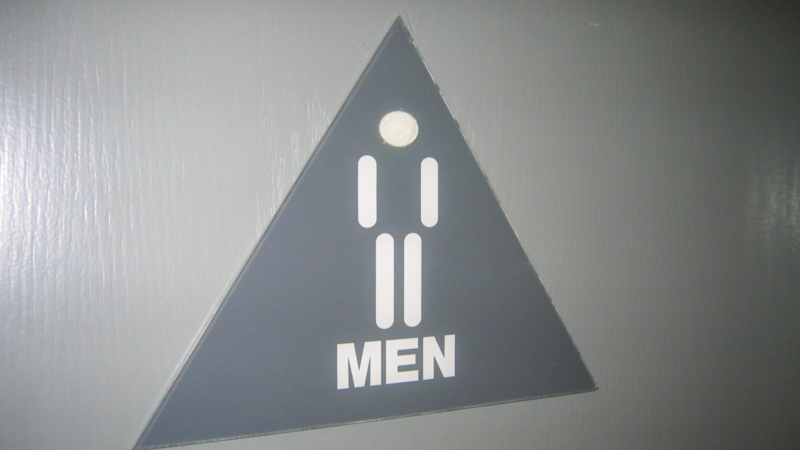 men sign toilet door