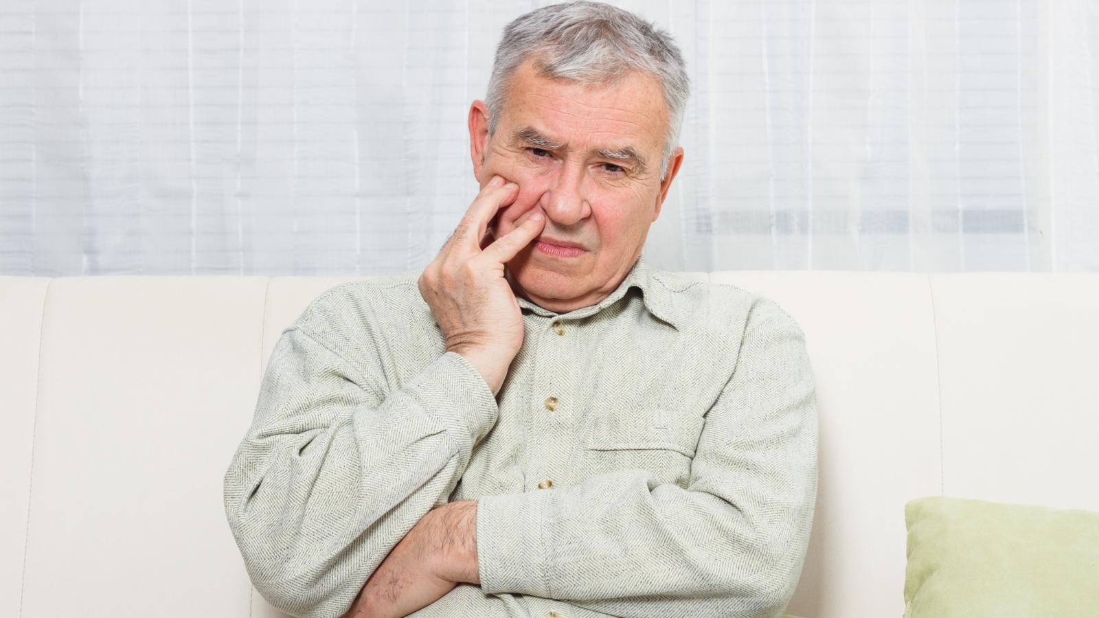 Older man with a sore mouth