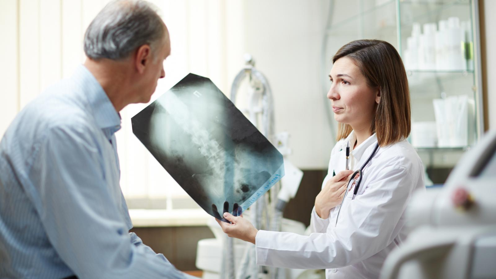 Doctor showing man an x-ray