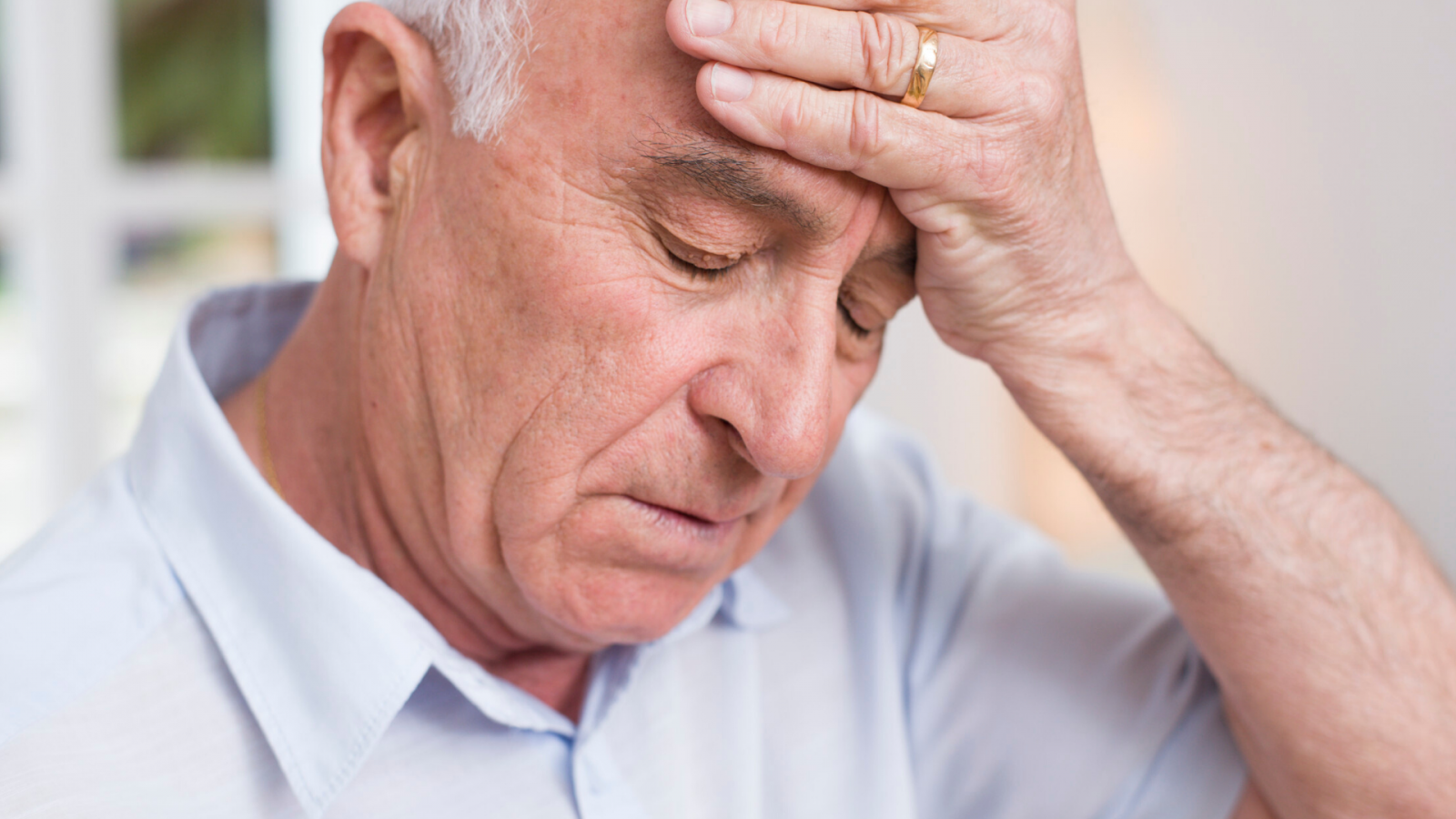 older man with headache