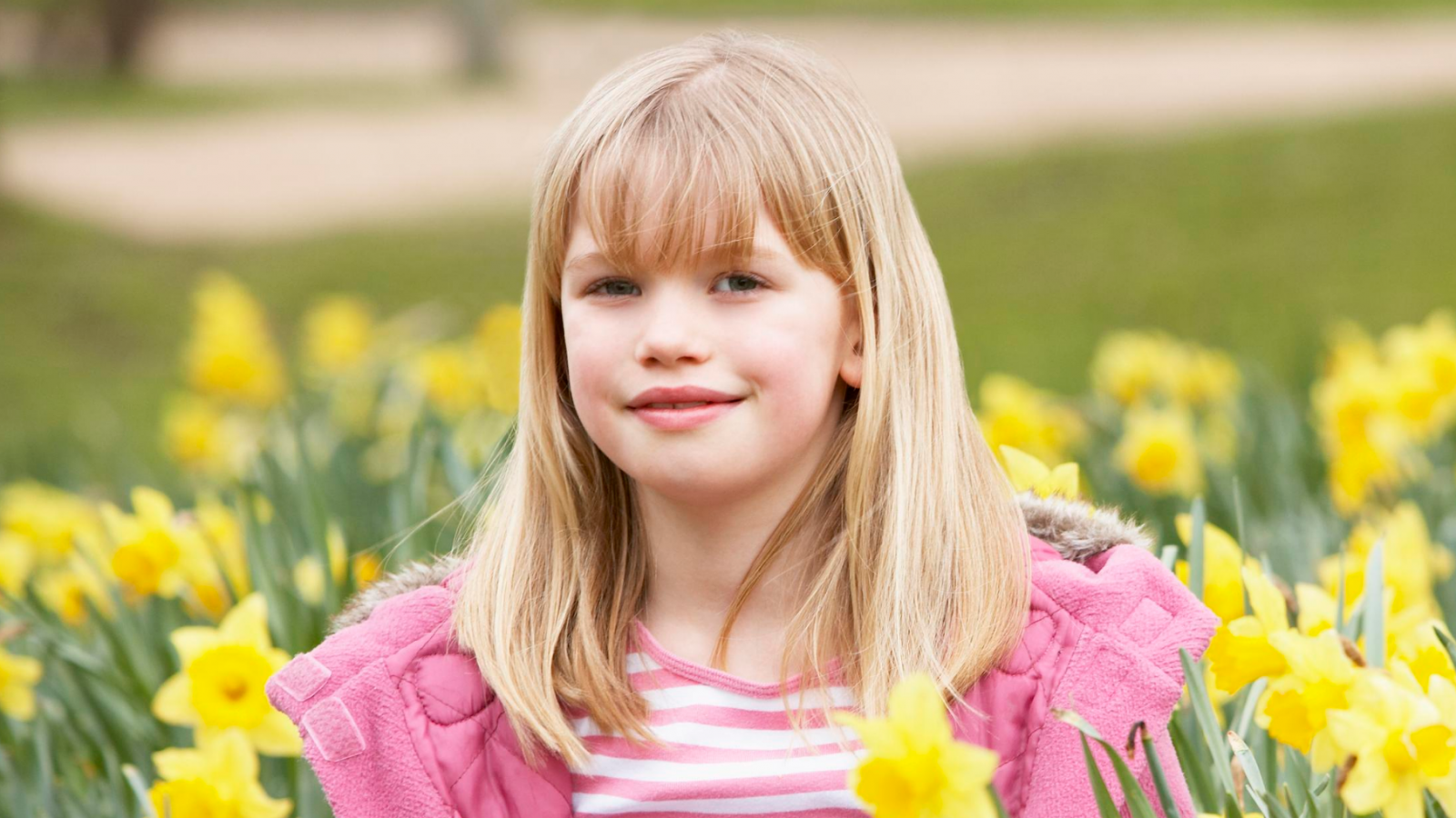 Girl surrounded by daffodils