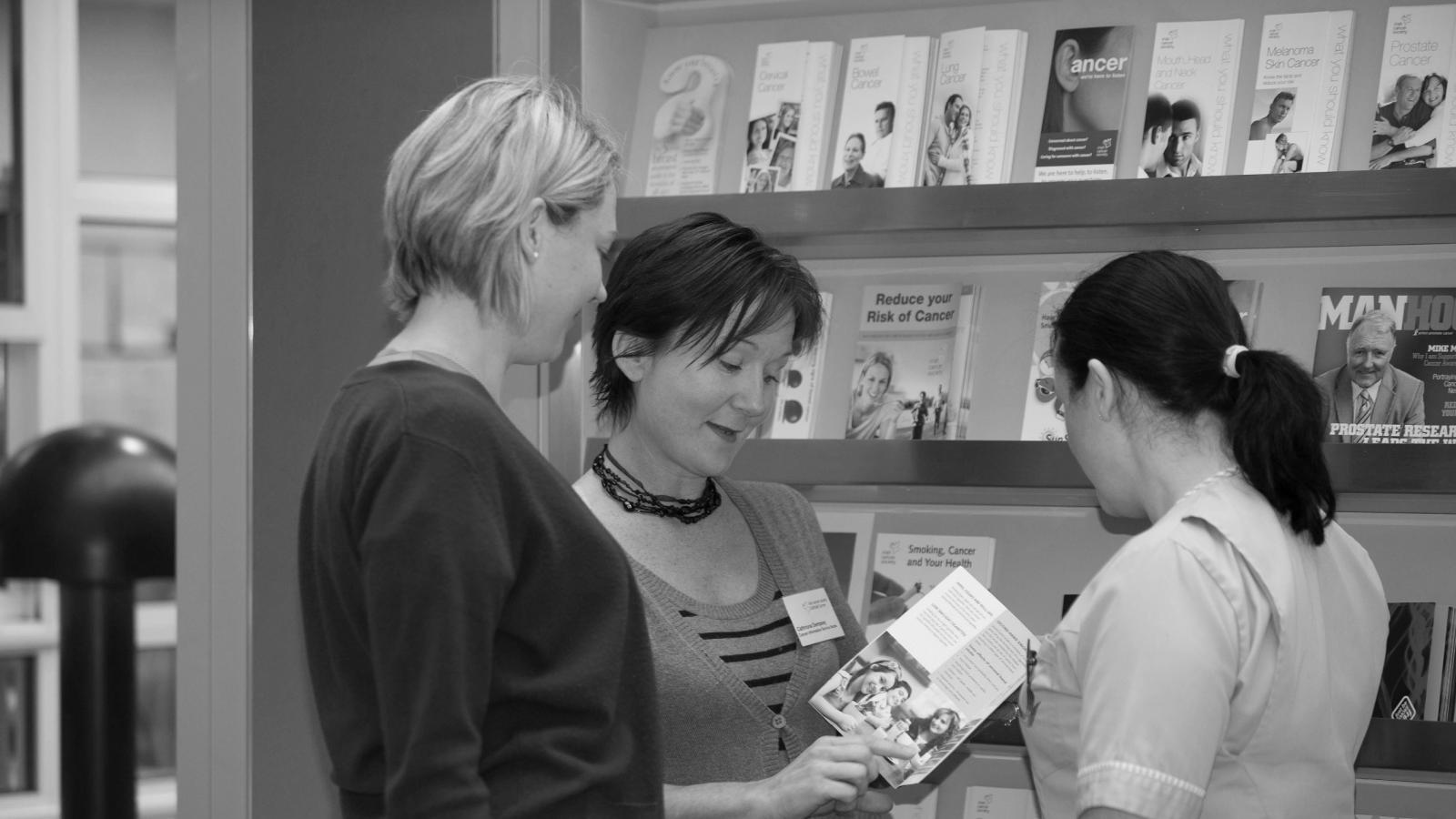 Women reading cancer publications