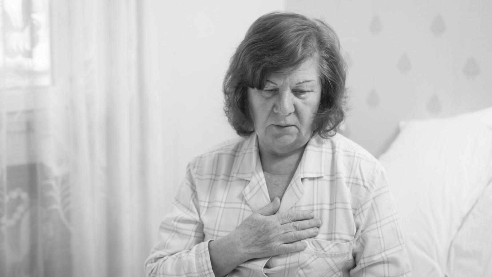 Older woman concerned at pain in her chest